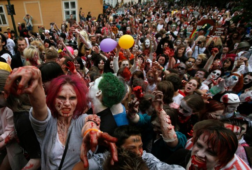 Enthusiasts dressed as zombies take part in a  Zombie Walk procession in Prague